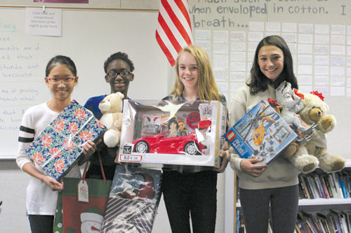 Kwonmin Kim, B'Anwi Fomukang, Georgia Evensen and Campbell Iezman with some of the toys being donated to Hillsides. (photo courtesy of Pattianna Harootian)