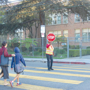 A crossing guard was stationed in front of Le Conte Middle School in Hollywood after the mother of a student was struck and killed in 2014 while walker her daughter to school. (photo by Edwin Folven)