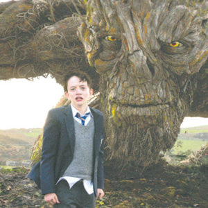 "A monster (voiced by Liam Neeson) helps Conor (Lewis MacDougall) cope with his mother's cancer in ""A Monster Calls."" (photo courtesy of Focus Features)"