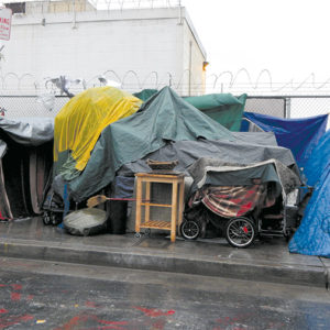 Many homeless individuals stay in tents or use tarps to protect themselves from the elements. It can sometimes be difficult to convince them to enter a formal shelter, according to an administrator for People Assisting the Homeless. (photo by Edwin Folven)