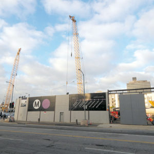 A new mixed-use development is proposed on the corner of Wilshire Boulevard and La Brea Avenue, adjacent to a future Purple Line subway station currently under construction. (photo by Edwin Folven)