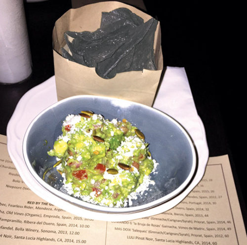 Blue corn tortilla chips come with smooth guacamole topped with pepitas and cotija cheese. (photo by Jill Weinlein)