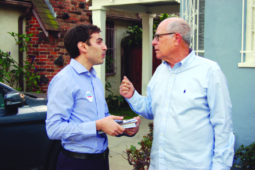 Jesse Max Creed, left, candidate for Los Angeles City Council, talks about development issues with resident David Genut. (photo by Gregory Cornfield)