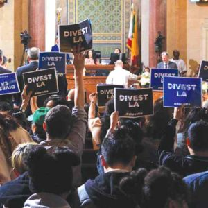 Protestors urged the City Council to divest from Wells Fargo at a meeting in March at City Hall. (photo courtesy of Divest LA)