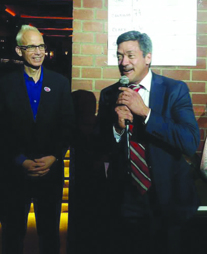 Councilman John Heilman, left, and Councilman John Duran celebrate early results on Tuesday that show they will return to their seats. (photo courtesy of Councilman John Duran)