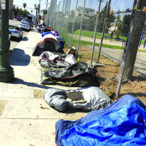 Homeless individuals set up along Cahuenga Boulevard earlier this year. (photos by Gregory Cornfield)