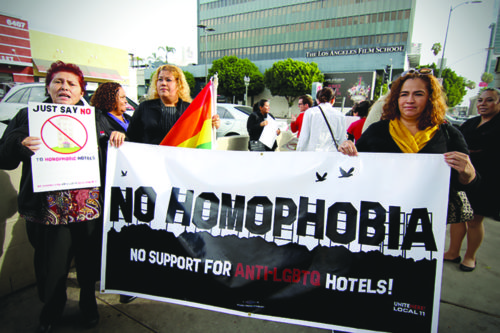 Opponents of the Ivar Garden Hotel proposal demonstrate in Hollywood against a construction company president who allegedly is associated with groups that promote discrimination. (courtesy of UNITE HERE Local 11)