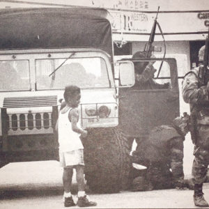This photo – published May 7, 1992, in the Park Labrea News and Beverly Press – shows local children interacting with the National Guard on Santa Monica Boulevard near Western Avenue. (photo by Josh Barash)