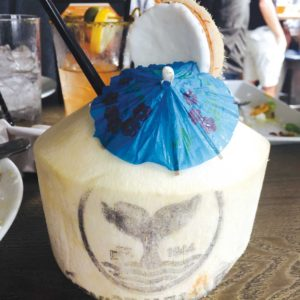 "Get your ""tourist"" on and order a coconut Paradise City for a fun, beachy drink. It's served non-alcoholic, but you can add vodka or rum if you wish. (photo by Jill Weinlein)"