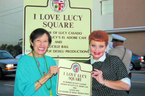 """Lucy Casado, owner of Lucy's El Adobe Cafe on Melrose Avenue, was shown with a Lucille Ball impersonator at a ceremony in 2007 to dedicate """"I Love Lucy Square."""" The intersection of Melrose Avenue and Plymouth Boulevard was named after the two famous Lucys – Casado, who owned the restaurant, and Ball, who filmed her famous television show across the street at Desilu Studios. (photo by Edwin Folven)"""