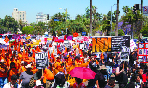 Demonstrators gathered near MacArthur Park before marching to City Hall on Monday to express opposition to new policies from the White House. (photo by Gregory Cornfield)