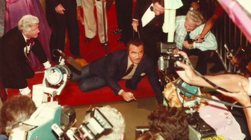 Burt Reynolds makes his mark at the Chinese Theatre in 1981. More than 300 stars have stylized a slab of concrete in the forecourt. (courtesy of the TCL Chinese Theatre)