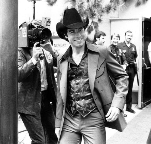 John Travolta celebrates his handprint ceremony in 1980.