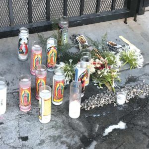 A memorial was placed on the sidewalk outside the victim's apartment building on Wilcox Avenue. (photo by Luke Harold)