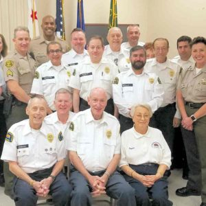 Volunteers at the West Hollywood Sheriff's Station are shown with former station commanding officer Holly Perez (second from right) and Lt. David Smith (right). (photo courtesy of the LASD)