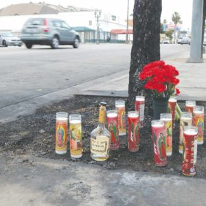 Flowers and candles were placed at the site of a collision on Hollywood Boulevard on May 14 that claimed the lives of two men. (photo by Edwin Folven)