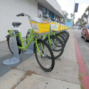 "West Hollywood's ""WeHo Pedals"" program offers bike sharing. Riders can find bicycles at stations throughout the city, including this one at Santa Monica Boulevard and Doheny Drive.  (photo by Edwin Folven)"