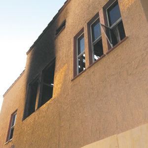 The flames damaged a second-floor unit. Transients may have been living inside the building. (photo by Edwin Folven)
