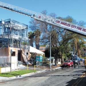 The fire damaged an apartment building under construction on Heliotrope Drive, as well as neighboring structures. (photo by Edwin Folven)
