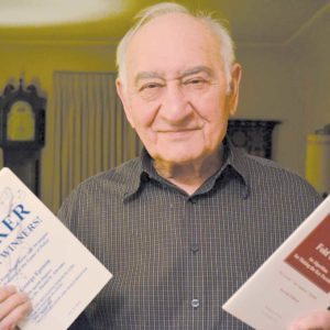 "George ""The Engineer"" Epstein was recognized with SAMPE's Kushner Award. He is pictured with books he authored on playing poker. (photo courtesy of the Epstein family)"