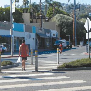 A pedestrian-activated traffic signal will be installed at Santa Monica Boulevard and Palm Avenue, one of four intersections along the boulevard designated for new signals. (photo by Edwin Folven)