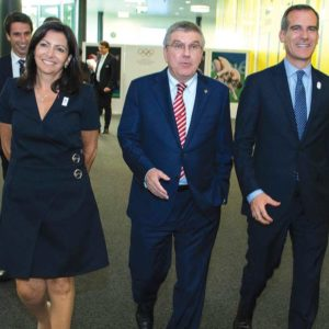 Paris Mayor Anne Hidalgo, IOC president Thomas Bach and Los Angeles Mayor Eric Garcettiat convened at the SwissTech Convention Centre in Lausanne. (photo courtesy of the International Olympic Committee/Greg Martin)