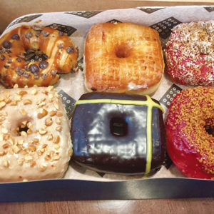 Colorful and delicious, Astro's doughnuts are stuffed, glazed and sprinkled with flavors like creme brulee, peach melba and maple bacon. (photo by Jill Weinlein)