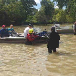Local firefighters and rescue volunteers in Northwest Houston worked this week to help residents evacuate the area.  (photo courtesy of Bobbie Wagner)
