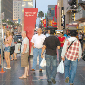 Police warn people to be aware of pickpocketers in crowded places like Hollywood Boulevard near Highland Avenue. (photo by Edwin Folven)
