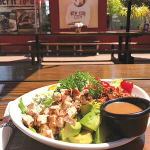 Burgers and fries, above right, and crisp delicious salads, like the Cobb are crowd favorites at Rock &Brews in El Segundo and at LAX. (photo by Jill Weinlein)