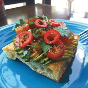 The avocado toast on di Abla's signature focaccia bursts with color and flavor. (photo courtesy of The Smile's di Alba)