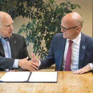 Gov. Jerry Brown (left) formally welcomed Norway to the Under2 Coalition by signing an agreement with Vidar Helgesen, Norway's minister of climate and the environment. (photo by Joe McHugh/ California Highway Patrol)