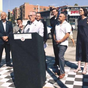 Councilman Mitch O'Farrell, 13th District, outlined improvements that will be made along Hollywood Boulevard west of Western Avenue. He was joined by other city officials and members of the Hollywood community. (photo courtesy of Councilman Mitch O'Farrell's Office)