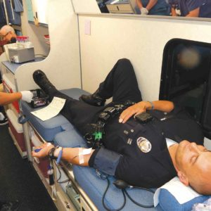 Officer Ashraf Hanna, of the LAPD's Hollywood Division, donated blood on Aug. 24. He said donating blood is part of a first responder's duty. (photo by Edwin Folven)