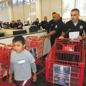 "Hollywood Division Officer Scott Gardner partnered with second-grader Bryan Velazquez during ""Shop With a Cop"" at Staples on Aug. 14. (photo by Edwin Folven)"