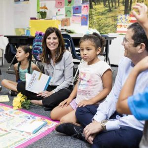 Andrea Sonnenberg, an attorney and co-founder and CEO of the organization, with young students who participated in Wise Readers to Leaders. Her husband Glenn (right) is involved with the organization as well. (photo courtesy of Max Gerber Photography)