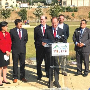 Rep. Adam Schiff (at the podium) joined Reps. Judy Chu (from left), Jimmy Gomez and Brad Sherman to support preserving the San Gabriel Mountains as a national monument. (photo by Luke Harold)