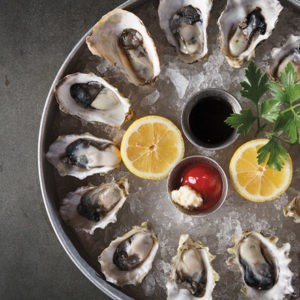 Oysters on the half shell come in several varieties, including Kusshi. (photo courtesy of COD Seafood House)