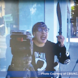 The female suspect was caught on camera after she returned to the DASH store with a machete. (photo provided by the L.A. County Sheriff's Department/courtesy of CBS/KCAL)