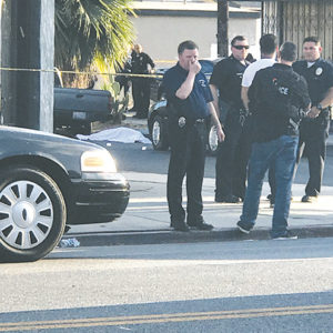 Police cordoned off the area around Melrose and Sierra Bonita avenues on Aug. 28 after a man was shot and killed. (photo by Peter Nichols)