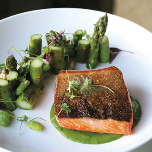 The King salmon with crispy skin is beautifully plated with lima beans and asparagus.  (photo courtesy of Wolf)