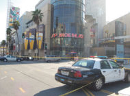 Police canvass the area around Hollywood and Highland after rapper is shot nearby