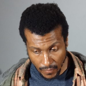 Authorities released a previous booking photograph of the suspect, Kisu Bradey Brown. (photo courtesy of LASD)
