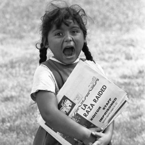 A young Chicanita hawks La Raza newspapers at the Poor People's Campaign, Washington, D.C. May-July in 1986. (Courtesy of Maria Varela)