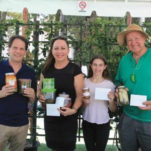 Ronald Sasiela (right) with Adam Wetsman, Michelle Wasserman and Elise Knebel showing off their winning pickles.