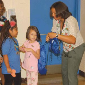 Representatives from Cedars-Sinai Medical Center gave students backpacks filled with supplies during an event at Rosewood Avenue Elementary School. (photo by Edwin Folven)