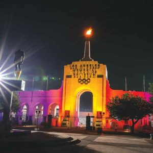 The Los Angeles Memorial Coliseum glowed with the colors of the LA 2028 logo in anticipation of Wednesday's vote by the International Olympic Committee to confirm Los Angeles as host of the 2028 Summer Games. (photo courtesy of the mayor's office)