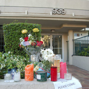 A memorial for the victims was placed in front of the apartment building at 939 Palm Avenue in 2014. (photo by Edwin Folven)