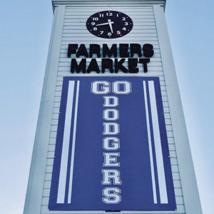 The iconic clock tower at the Original Farmers Market has a banner supporting the Dodgers.