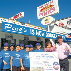 Richard and Gloria Pink and the employees at Pink's Hot Dogs are celebrating the Los Angeles Dodgers playing the World Series with a special hot dog and Dodger blue decorations. (photo by Edwin Folven)